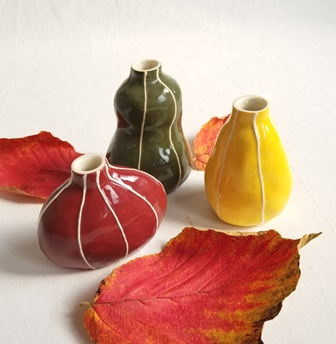 Bud vase group, autumn colors